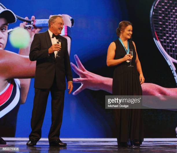 John Newcombe medallist Ashleigh Barty stands on the podium with John Newcombe at the 2017 Newcombe Medal at Crown Palladium on November 27 2017 in...