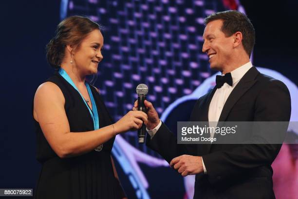 John Newcombe medallist Ashleigh Barty with host Rove McManus at the 2017 Newcombe Medal at Crown Palladium on November 27 2017 in Melbourne Australia