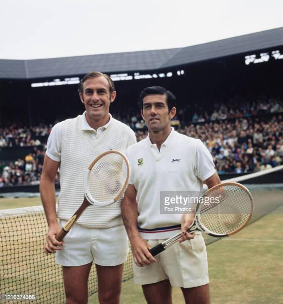 John Newcombe of Australia and compatriot Ken Rosewall pose for photographs before their Men's Singles Final match at the Wimbledon Lawn Tennis...