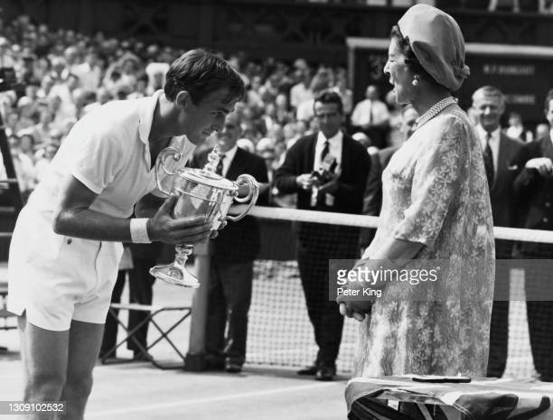 John Newcombe of Australia bows to Princess Marina the Duchess of Kent after being presented with the Gentlemen's Singles Championship Trophy after...