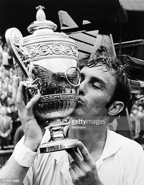 John Newcombe, of Australia, kisses the trophy he received July 4th when he won the Men's Singles of the Wimbledon Lawn Tennis Championships here. He...