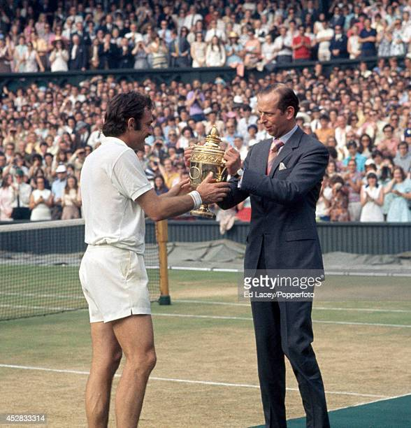 John Newcombe of Australia winner of the Men's Singles Final is presented with the trophy by the Duke of Kent on Centre Court at Wimbledon on 3rd...