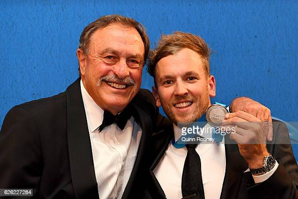 John Newcombe poses with Dylan Alcott after he won the Newcombe Medal at the 2016 Newcombe Medal at Crown Palladium on November 28 2016 in Melbourne...