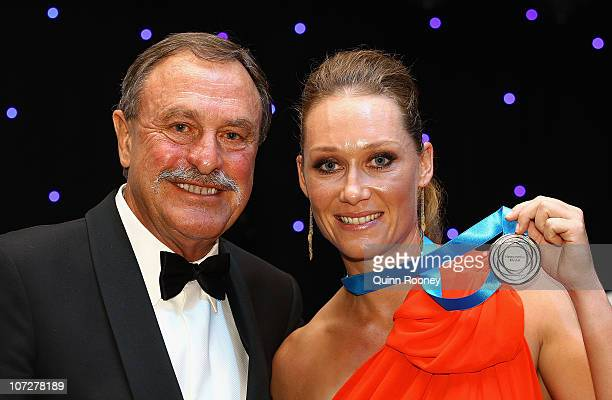 John Newcombe poses with Sam Stosur the winner of the Newcombe Medal at the Newcombe Medal Awards at Melbourne Park on December 3 2010 in Melbourne...