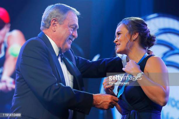 John Newcombe presents Ashleigh Barty with the Newcombe Medal during the 2019 Newcombe Medal at Crown Palladium on December 02 2019 in Melbourne...