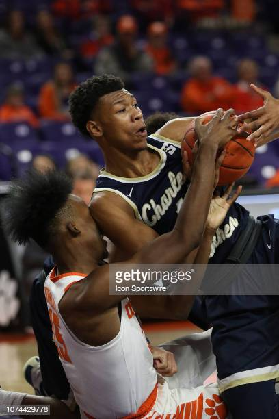 John Newman III guard of Clemson and Christian Keeling of Charleston Southern scramble for a lose ball during a college basketball game between the...