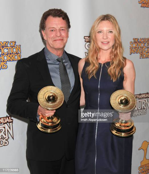 John Noble and Anna Torv pose in the Press Room at the 37th Annual Saturn Awards at The Castaway> on June 23 2011 in Los Angeles California