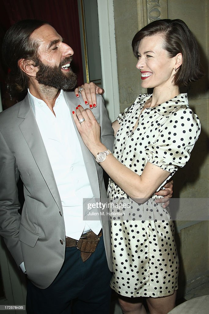 John Nollet and Milla Jovovich attend the Founder And CEO Alessandro Savelli And Contemporary Style Icon Julia Restoin Roitfeld Launch SAVELLI The World's First Luxury Smart Phone Especially For Women During Haute Couture Week at Musee Jacquemart-Andre on July 3, 2013 in Paris, France.