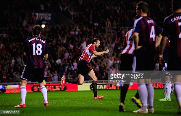 John O' Shea of Sunderland celebrates his goal during the Barclays Premier League match between Sunderland and Stoke City at the Stadium of Light on...