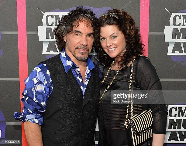 John Oates and Aimee Oates attend the 2013 CMT Music awards at the Bridgestone Arena on June 5 2013 in Nashville Tennessee