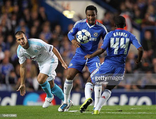 John Obi Mikel battles with Benoit Cheyrou during the UEFA Champions League Group F match between Chelsea and Marseille at Stamford Bridge on...
