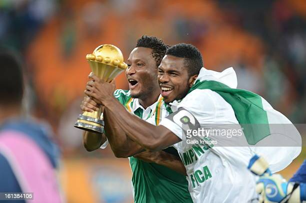 John Obi Mikel celebrates holding the trophy during the 2013 Orange African Cup of Nations Final match between Nigeria and Burkina Faso from the...