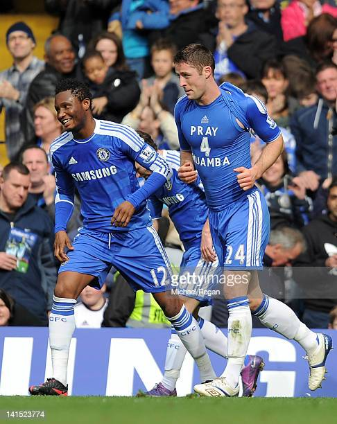 John Obi Mikel celebrates with goal scorer Gary Cahill who shows his support for Fabrice Muamba during the FA Cup sixth round match between Chelsea...