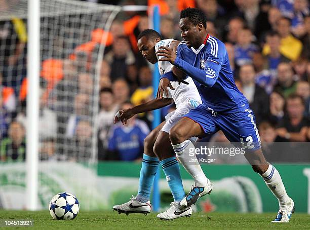 John Obi Mikel of Chelsea battles for the ball with Edouard Cisse of Marseille during the UEFA Champions League Group F match between Chelsea and...