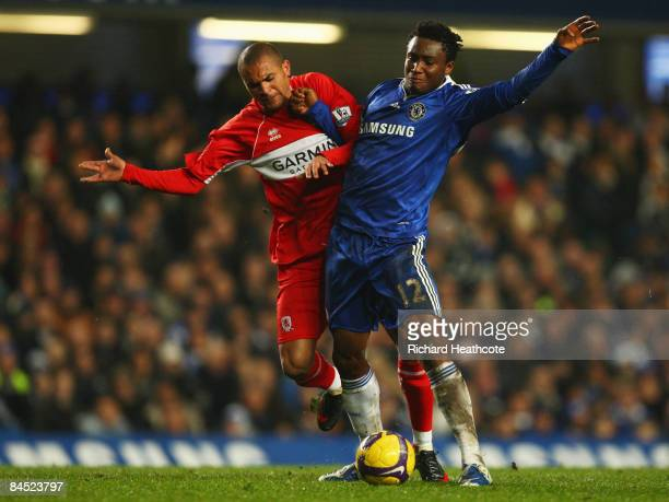 John Obi Mikel of Chelsea battles with Afonso Alves of Middlesbrough during the Barclays Premier League match between Chelsea and Middlesbrough at...