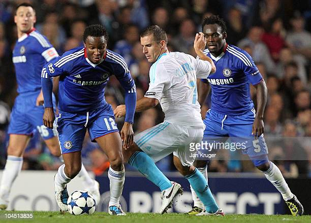 John Obi Mikel of Chelsea battles with Benoit Cheyrou of Marseille during the UEFA Champions League Group F match between Chelsea and Marseille at...