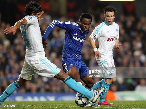John Obi Mikel of Chelsea battles with Lucho Gonzalez of Marseille during the UEFA Champions League Group F match between Chelsea and Marseille at...