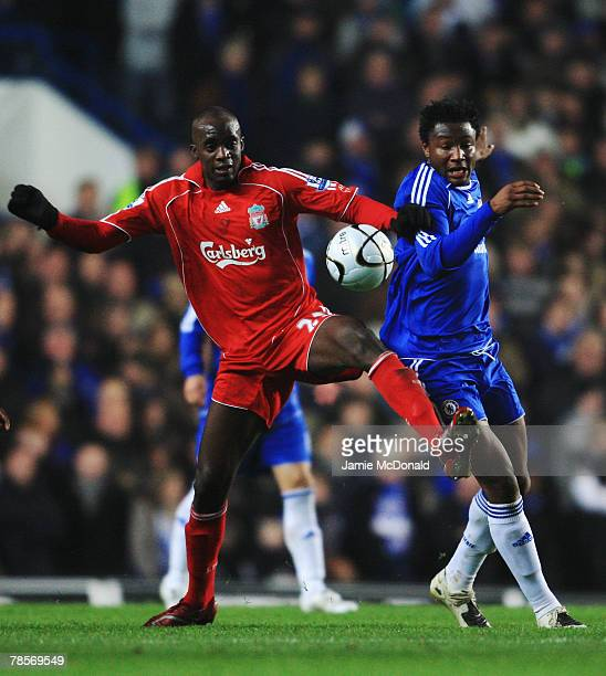 John Obi Mikel of Chelsea challenges Momo Sissoko of Liverpool during the Carling Cup Quarter Final match between Chelsea and Liverpool at Stamford...