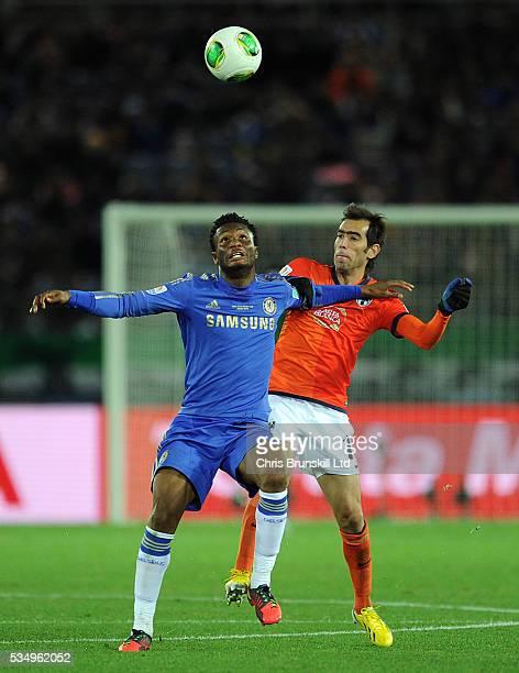 John Obi Mikel of Chelsea FC and Cesar Delgado of CF Monterrey