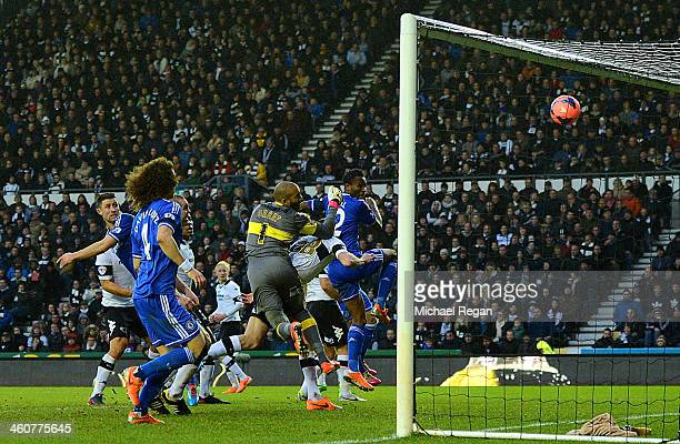 John Obi Mikel of Chelsea heads the ball to score their first goal during the Budweiser FA Cup Third Round match between Derby County and Chelsea at...
