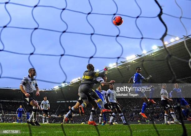 John Obi Mikel of Chelsea heads the ball to score their first goal PAST Lee Grant of Derby during the Budweiser FA Cup Third Round match between...