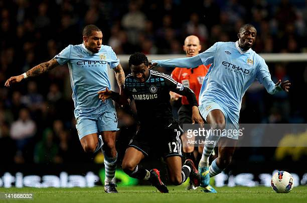 John Obi Mikel of Chelsea is forced off the ball by Nigel De Jong and Yaya Toure of Manchester City during the Barclays Premier League match between...