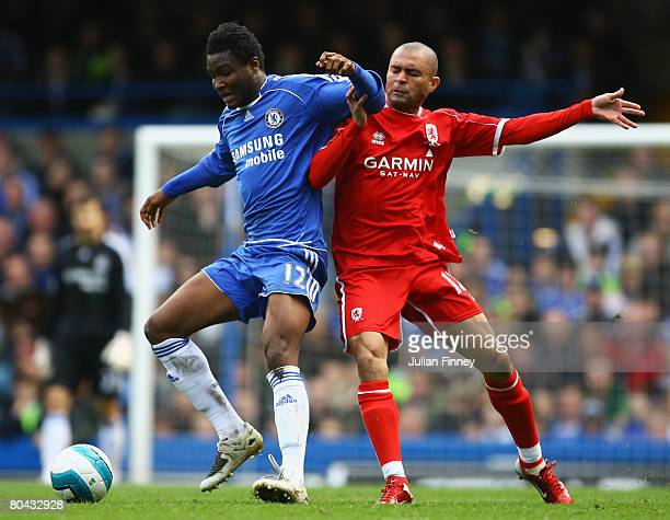 John Obi Mikel of Chelsea tangles with Afonso Alves of Middlesbrough during the Barclays Premier League match between Chelsea and Middlesbrough at...