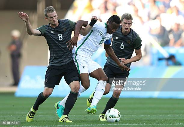 John Obi Mikel of Nigeria competes for the ball with Lars Bender of Germany and Sven Bender of Germany during the Men's Semifinal Football match...