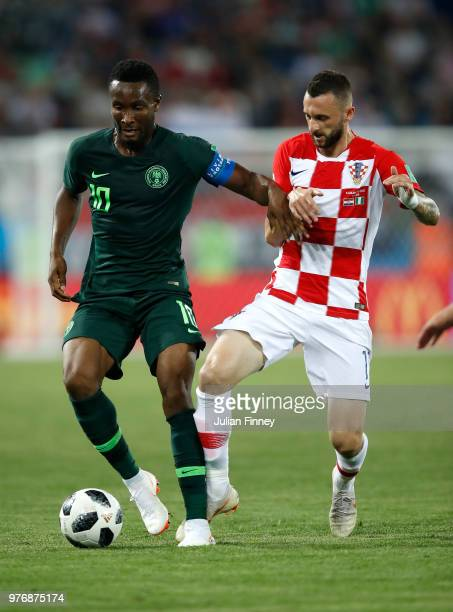 John Obi Mikel of Nigeria holds off Marcelo Brozovic of Croatia during the 2018 FIFA World Cup Russia group D match between Croatia and Nigeria at...