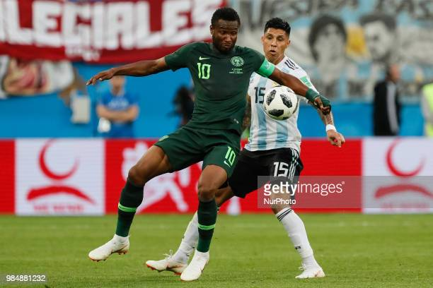 John Obi Mikel of Nigeria national team and Enzo Perez of Argentina national team during the 2018 FIFA World Cup Russia group D match between Nigeria...