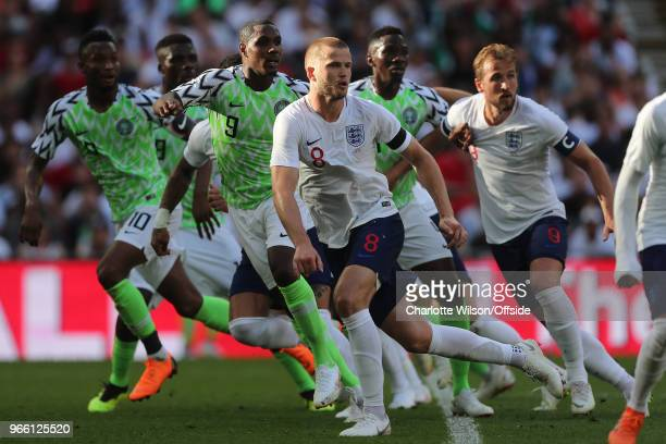 John Obi Mikel of Nigeria Odion Ighalo of Nigeria Eric Dier of England and Harry Kane of England run in for a free kick during the International...