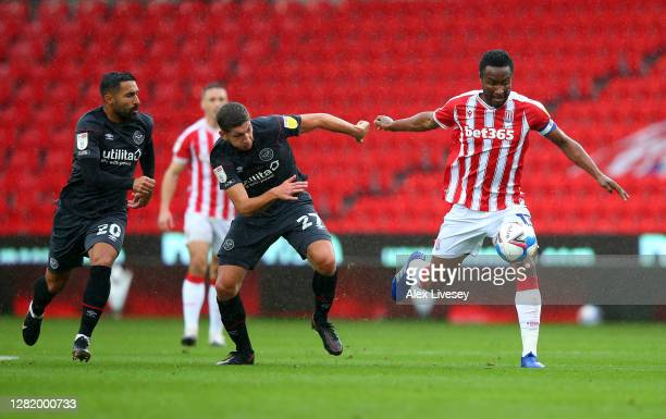 John Obi Mikel of Stoke City battles for possession with Vitaly Janelt of Brentford during the Sky Bet Championship match between Stoke City and...