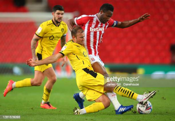 John Obi Mikel of Stoke City is tackled by Herbie Kane of Barnsley during the Sky Bet Championship match between Stoke City and Barnsley at Bet365...