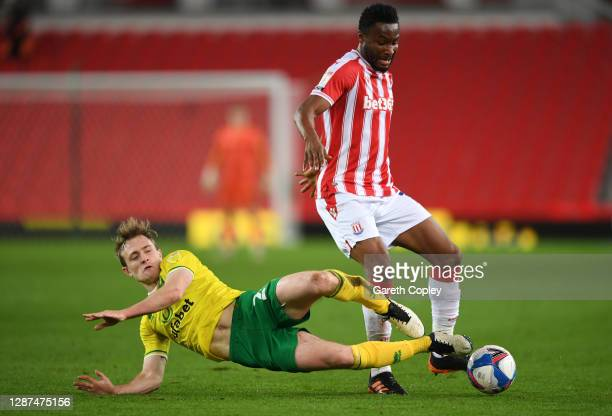 John Obi Mikel of Stoke City is tackled by Oliver Skipp of Norwich City during the Sky Bet Championship match between Stoke City and Norwich City at...