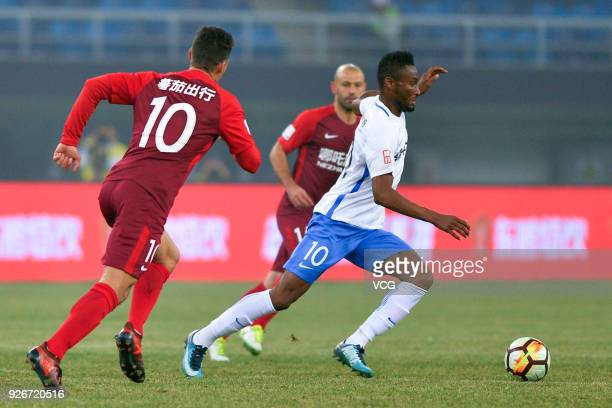 John Obi Mikel of Tianjin Teda follows the ball during the 2018 Chinese Football Association Super League first round match between Tianjin Teda and...