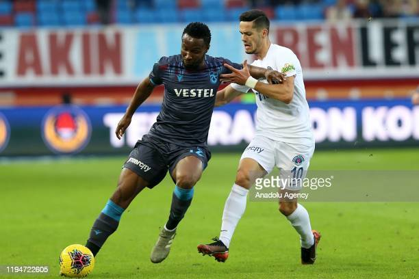 John Obi Mikel of Trabzonspor in action against Haris Hajradinovic of Kasimpasa during the Turkish Super Lig soccer match between Trabzonspor and...