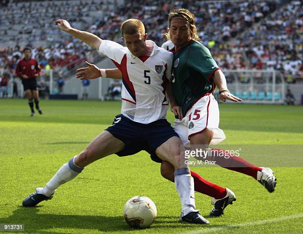 John O'Brien of the USA holds off Luis Hernandez of Mexico during the Mexico v USA World Cup Second Round match played at the Jeonju World Cup...