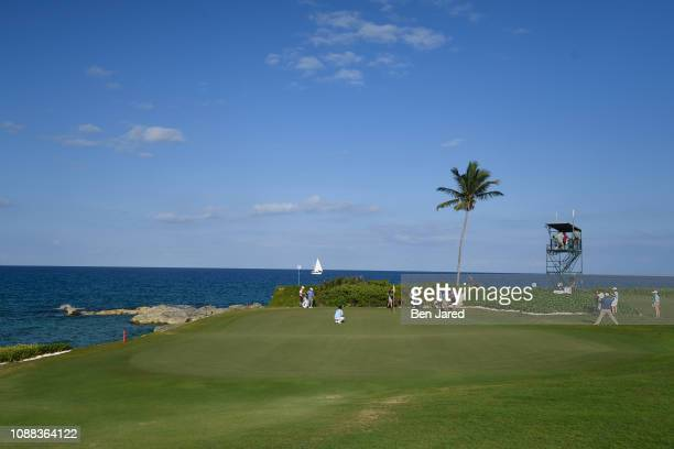 John Oda, Zecheng Dou of China and Willy Wilcox stand on the thirteenth hole green during the third round of the Web.com Tour's The Bahamas Great...