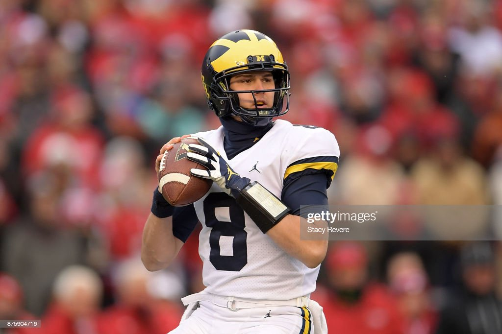 John O'Korn #8 of the Michigan Wolverines drops back to pass during the third quarter of a game against the Wisconsin Badgers at Camp Randall Stadium on November 18, 2017 in Madison, Wisconsin.