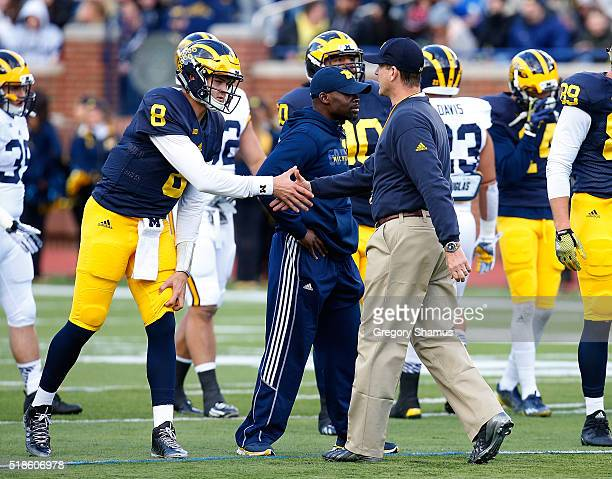 John O'Korn of the Michigan Wolverines shakes hands with head coach Jim Harbaugh prior to the Michigan Football Spring Game on April 1 2016 at...