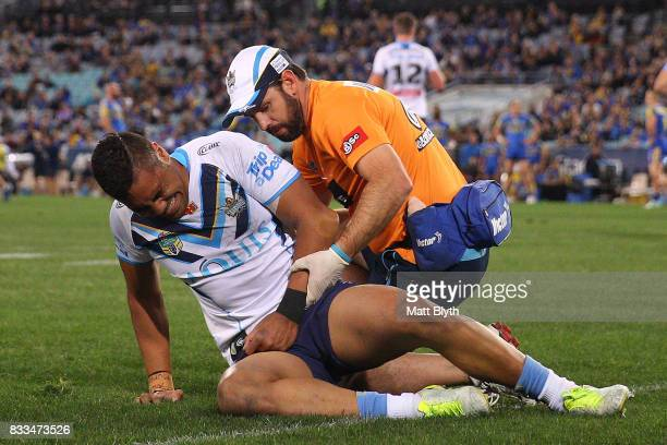 John Olive of the Titans yells in pain after injuring his arm during the round 24 NRL match between the Parramatta Eels and the Gold Coast Titans at...