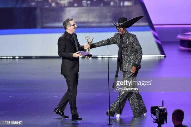"""John Oliver accepts the Oustanding Variety Talk Series award for """"Last Week Tonight With John Oliver"""" from Billy Porter onstage during the 71st Emmy..."""