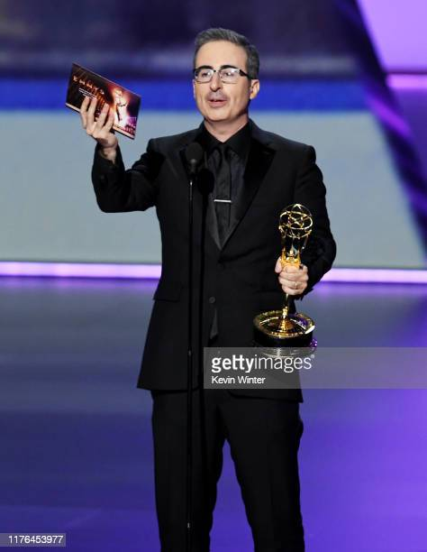 John Oliver accepts the Outstanding Variety Talk Series award for 'Last Week Tonight with John Oliver' onstage during the 71st Emmy Awards at...