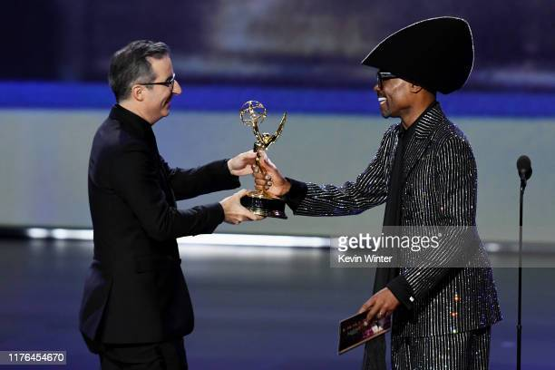 John Oliver accepts the Outstanding Variety Talk Series award for 'Last Week Tonight with John Oliver' from Billy Porter onstage during the 71st Emmy...
