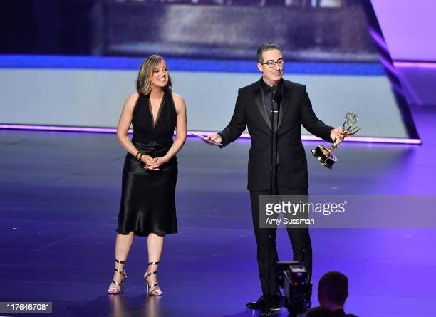 John Oliver accepts the Outstanding Variety Talk Series award for 'Last Week Tonight with John Oliver' from Liz Stanton onstage during the 71st Emmy...