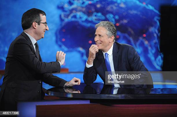 John Oliver and host Jon Stewart appear on The Daily Show with Jon Stewart #JonVoyage on August 6 2015 in New York City