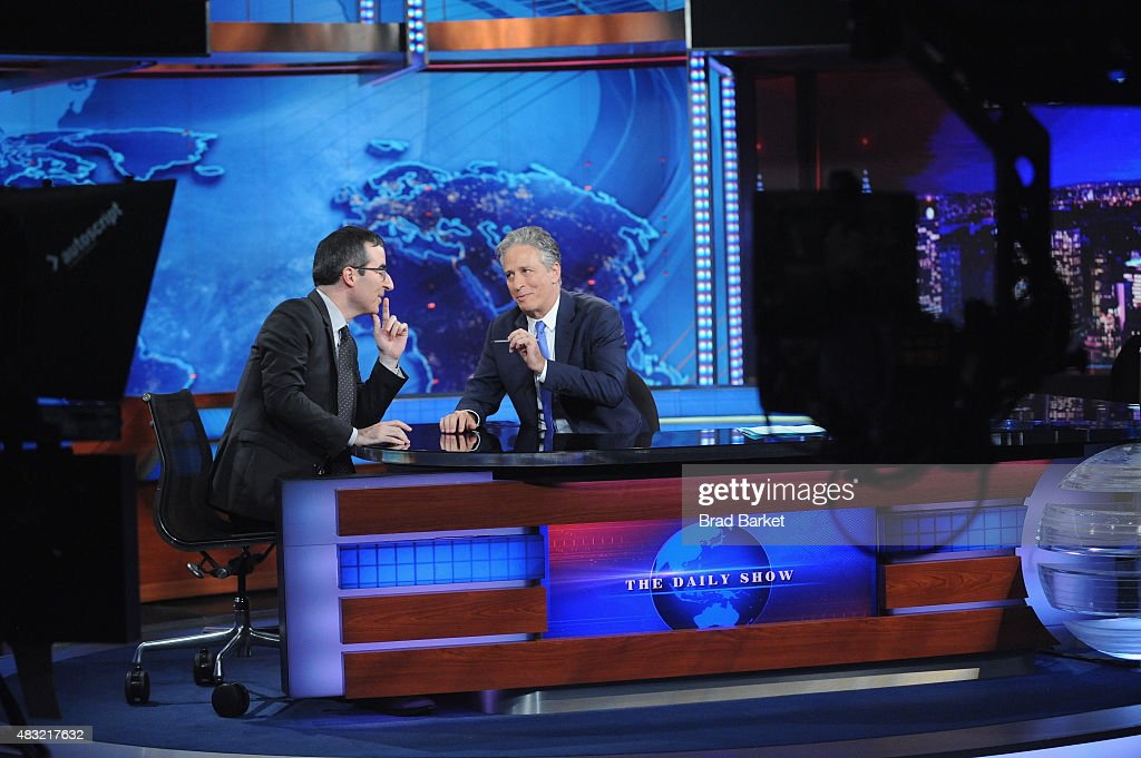 John Oliver and host Jon Stewart appear on 'The Daily Show with Jon Stewart' #JonVoyage on August 6, 2015 in New York City.