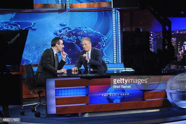 John Oliver and host Jon Stewart appear on 'The Daily Show with Jon Stewart' #JonVoyage on August 6 2015 in New York City
