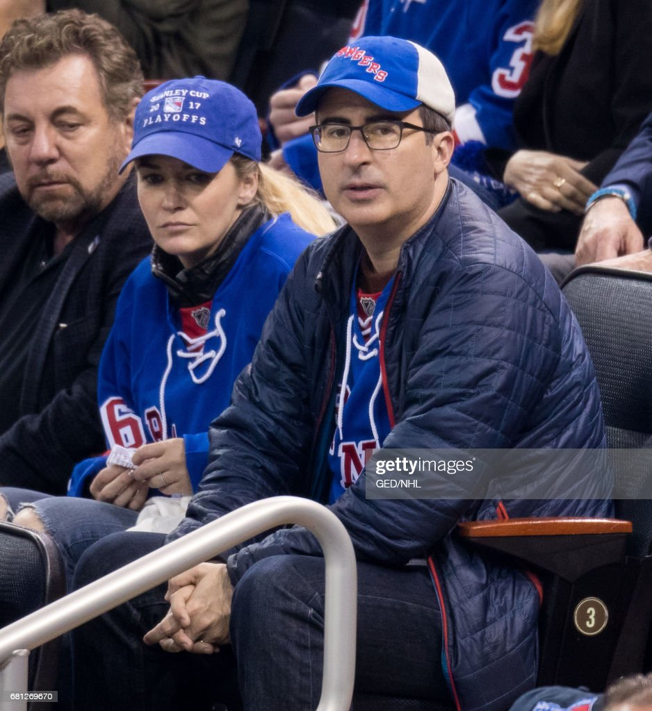 John Oliver and Kate Norley attend Ottawa Senators Vs. New York Rangers 2017 Playoff Game on May 9, 2017, at Madison Square Garden in New York City.