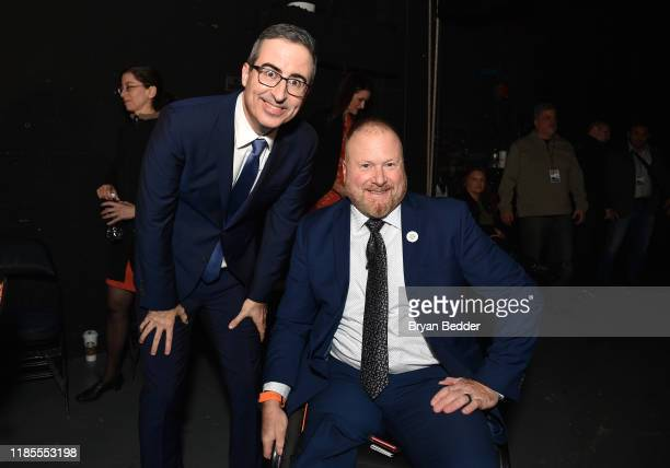 John Oliver and Pete Way pose backstage during the 13th annual Stand Up for Heroes to benefit the Bob Woodruff Foundation at The Hulu Theater at...